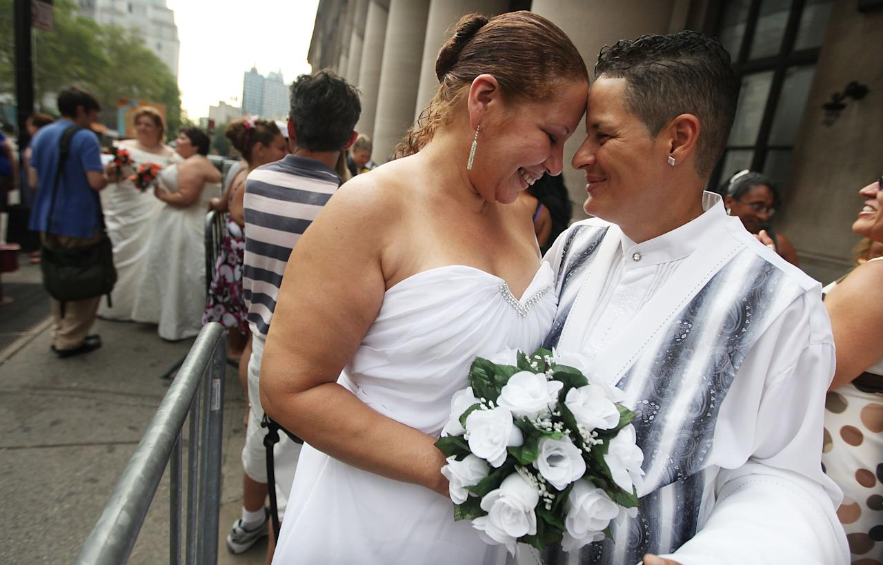 NEW YORK, NY - JULY 24:  Maira Garcia (R) and Maria Vargas wait on line to get married at the Brooklyn City Clerk's office on July 24, 2011 in New York City. Today was the first day gay couples were allowed to legally marry in New York state.  (Photo by Mario Tama/Getty Images)