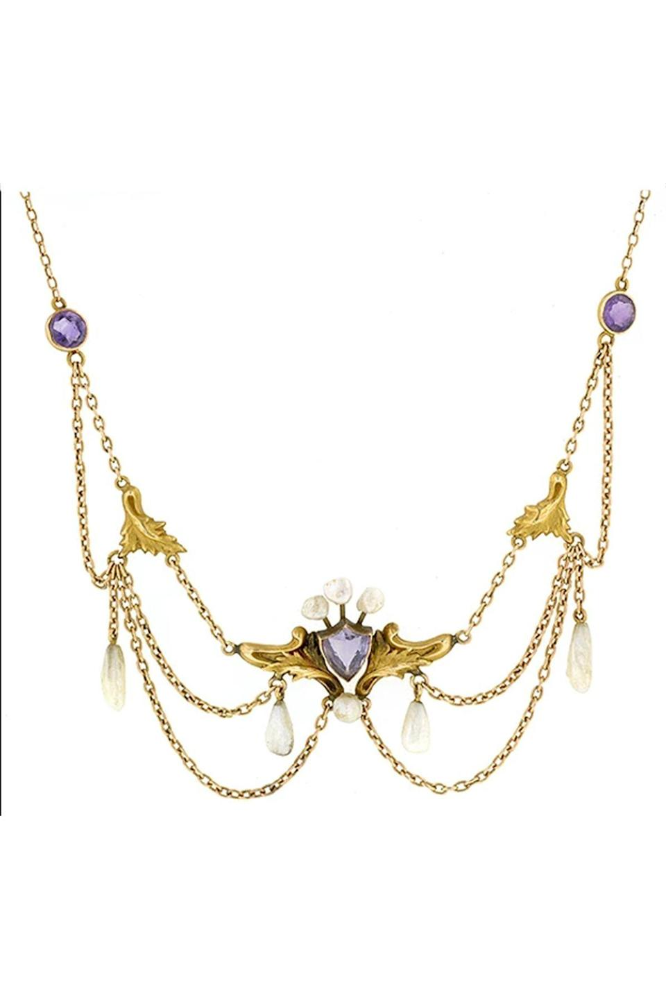 """<p><strong>Doyle & Doyle</strong></p><p>doyledoyle.com</p><p><strong>$1600.00</strong></p><p><a href=""""https://doyledoyle.com/products/art-nouveau-amethyst-pearl-festoon-necklace-2"""" rel=""""nofollow noopener"""" target=""""_blank"""" data-ylk=""""slk:Shop Now"""" class=""""link rapid-noclick-resp"""">Shop Now</a></p><p>The draping chains of this amethyst and pearl festoon are ornamented by gold leaves and pearls—a hallmark of the design era. </p>"""