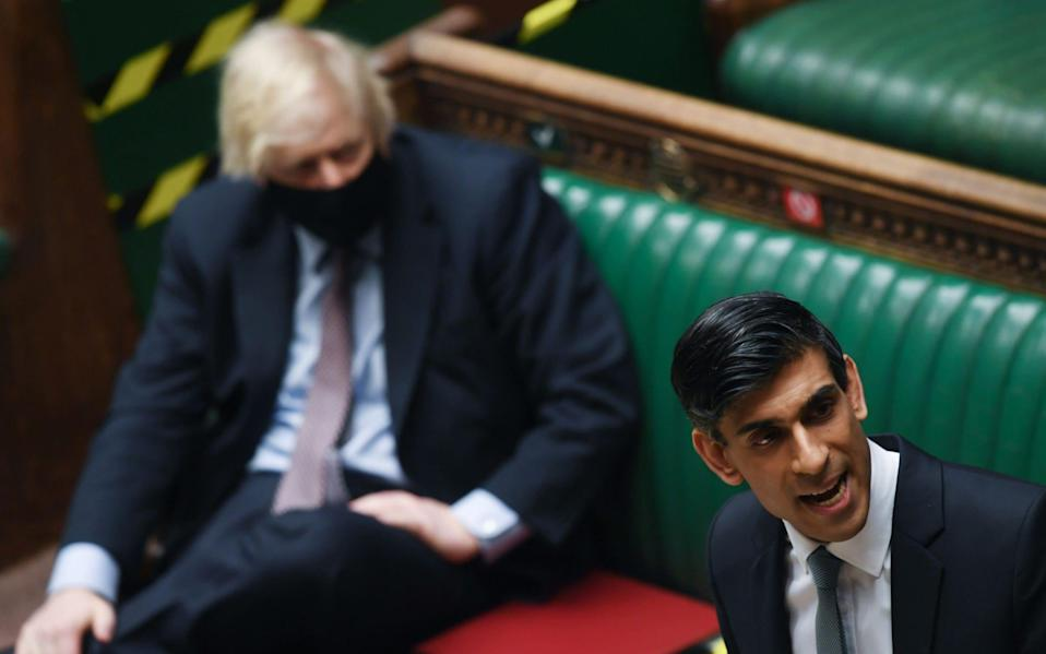 Rishi Sunak delivers his Budget, with Boris Johnson sitting nearby - shutterstock