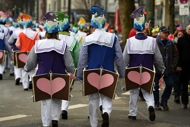 <p>Dressed-up people take part in a carnival parade on Rose Monday on Feb. 12, 2018 in Duesseldorf, western Germany. (Photo: Patrik Stollarz/Getty Images) </p>