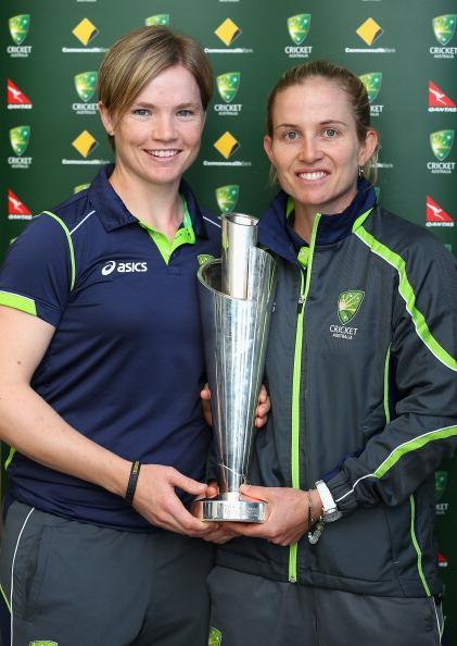 MELBOURNE, AUSTRALIA - OCTOBER 09: Jessica Cameron and Jodie Fields of the Southern Stars pose with the trophy after arriving back home to Australia after winning the 2012 ICC Women's T20 World Cup, at Melbourne International Airport on October 9, 2012 in Melbourne, Australia.  (Photo by Quinn Rooney/Getty Images)