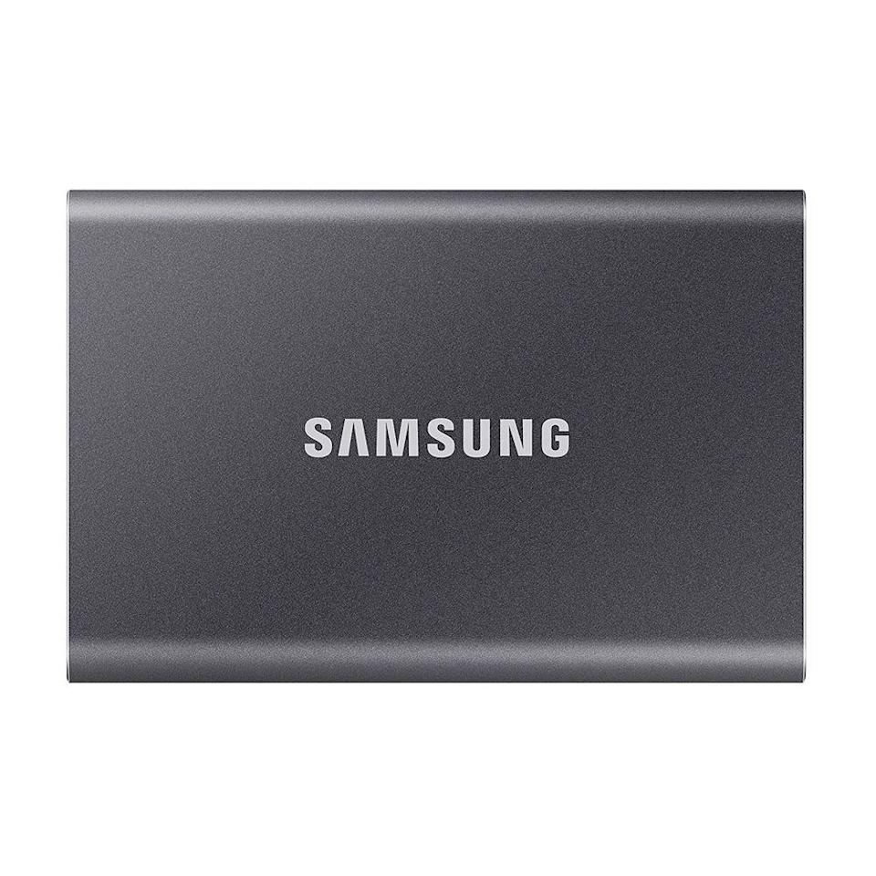 """<p><strong>Samsung</strong></p><p>amazon.com</p><p><strong>$89.99</strong></p><p><a href=""""https://www.amazon.com/dp/B0874YS2N7?tag=syn-yahoo-20&ascsubtag=%5Bartid%7C2089.g.2817%5Bsrc%7Cyahoo-us"""" rel=""""nofollow noopener"""" target=""""_blank"""" data-ylk=""""slk:Shop Now"""" class=""""link rapid-noclick-resp"""">Shop Now</a></p><p>One of the most important laptop accessories you could possibly purchase is a portable, solid-state drive to back up your files. </p><p>This one is just half an inch thick, and it's small enough to fit in a laptop bag or sleeve. It has quick read and write times, up to a 2 TB storage capacity, and it works with Windows and Mac laptops. It's backed by a 3-year warranty. </p><p>If you're looking for something more rugged, consider the <a href=""""https://www.amazon.com/dp/B078SWJ3CF/?tag=syn-yahoo-20&ascsubtag=%5Bartid%7C2089.g.2817%5Bsrc%7Cyahoo-us"""" rel=""""nofollow noopener"""" target=""""_blank"""" data-ylk=""""slk:water-resistant SanDisk Extreme Pro"""" class=""""link rapid-noclick-resp"""">water-resistant SanDisk Extreme Pro</a>.</p>"""