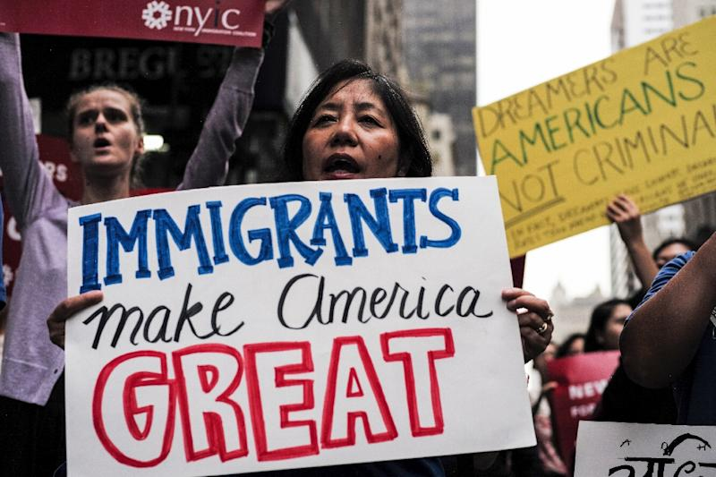 """Amnesty took particular aim at the US president's """"transparently hateful"""" executive order banning entry to citizens of several Muslim-majority countries. (AFP Photo/Jewel SAMAD)"""