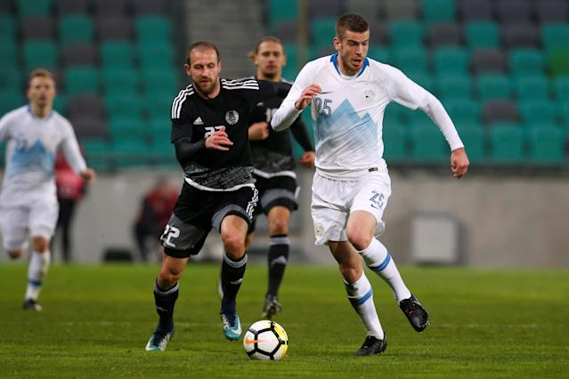 Soccer Football - International Friendly - Slovenia vs Belarus - Stozice Stadium, Ljubljana, Slovenia - March 27, 2018 Slovenia's Domen Crnigoj in action with Belarus' Igor Stasevich REUTERS/Borut Zivulovic