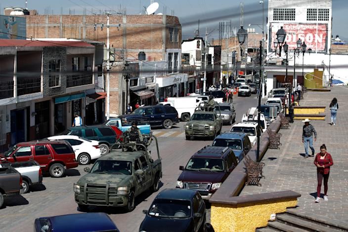 National Guard patrol vehicles drive through the central square in Apaseo el Alto, Guanajuato state, Mexico. The two most powerful drug cartels in the hemisphere are battling over this industrial and farming hub. (AP Photo/Rebecca Blackwell, File) (AP)