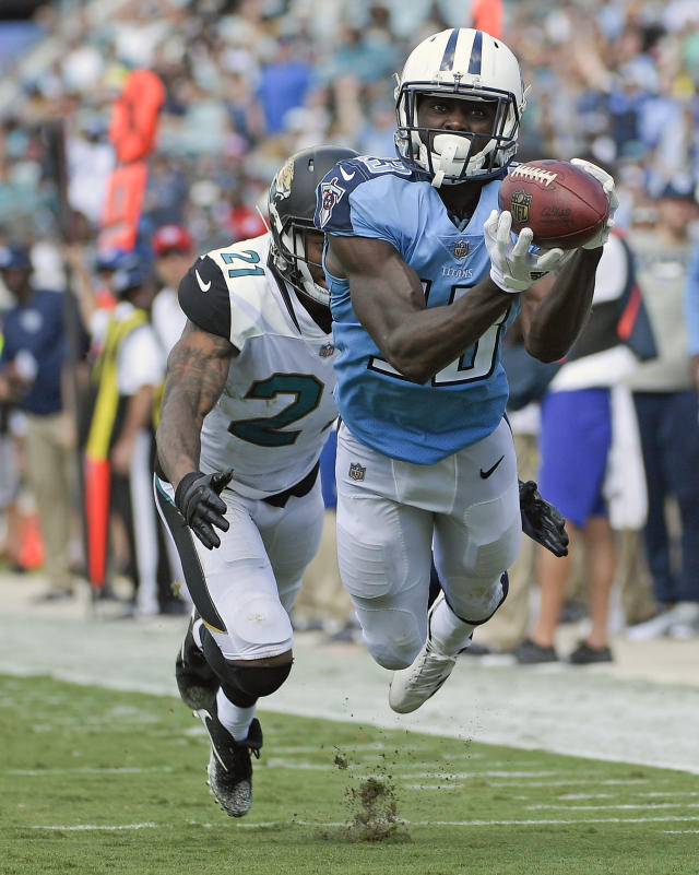 <p>Tennessee Titans wide receiver Taywan Taylor, right, makes a reception in front of Jacksonville Jaguars cornerback A.J. Bouye (21) during the second half of an NFL football game, Sunday, Sept. 17, 2017, in Jacksonville, Fla. (AP Photo/Phelan M. Ebenhack) </p>