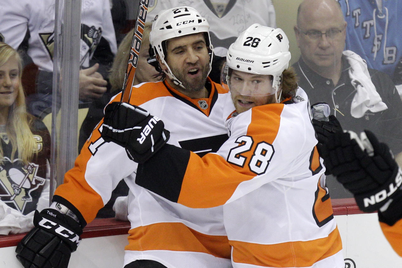 Philadelphia Flyers' Maxime Talbot (27) celebrates his first-period goal with teammate Claude Giroux (28) during Game 2 of an opening-round NHL hockey playoff series against the Pittsburgh Penguins in Pittsburgh Friday, April 13, 2012. (AP Photo/Gene J. Puskar)