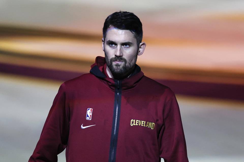 Kevin Love waits to be introduced before an NBA game.