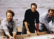 <p>Richard Dreyfuss, Roy Scheider, and Robert Shaw on board a boat in a still from the film <em>Jaws</em>, in 1975.</p>