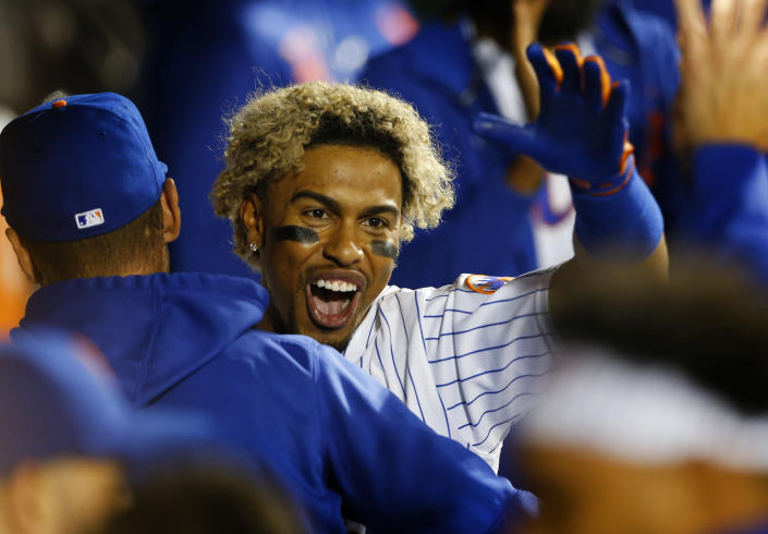 New York Mets' Francisco Lindor celebrates in the dugout after hitting a home run against the New York Yankees during the eighth inning of a baseball game on Sunday, Sept. 12, 2021, in New York. (AP Photo/Noah K. Murray)