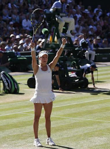 Eugenie Bouchard of Canada turns to family, friends and coach as she celebrates defeating Simona Halep of Romania in their women's singles semifinal match at the All England Lawn Tennis Championships in Wimbledon, London, Thursday, July 3, 2014. (AP Photo/Pavel Golovkin)