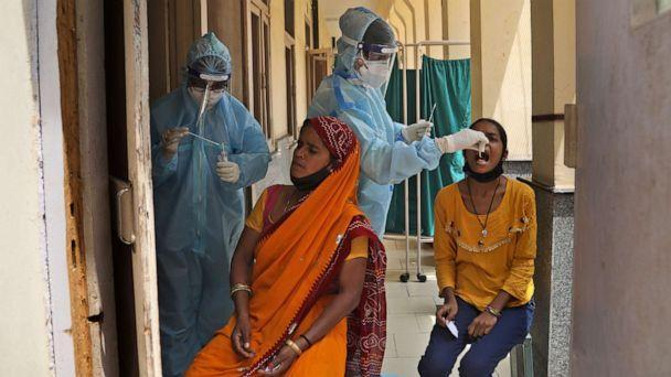 PHOTO: Health workers collect swab samples to test for COVID-19 in New Delhi, India, Friday, April 16, 2021. (Manish Swarup/AP)