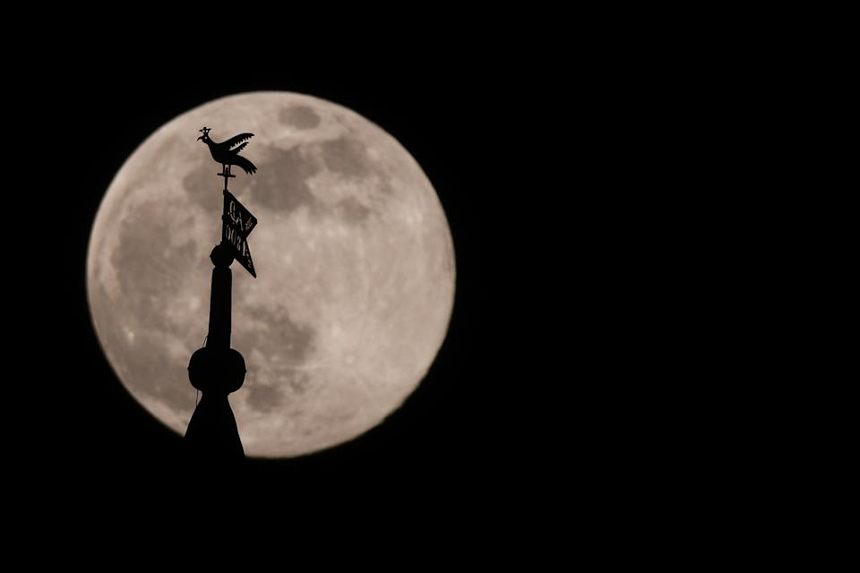 A view of the'pink moon, or April full moon the closest supermoon of the year seen over Krakow. On Wednesday