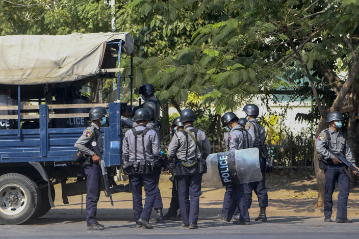 Police in riot gear are deployed ahead of demonstrations against the military coup in Mandalay, Myanmar, Wednesday, Feb. 17, 2021. The U.N. expert on human rights in Myanmar warned of the prospect for major violence as demonstrators gather again Wednesday to protest the military's seizure of power. (AP Photo)
