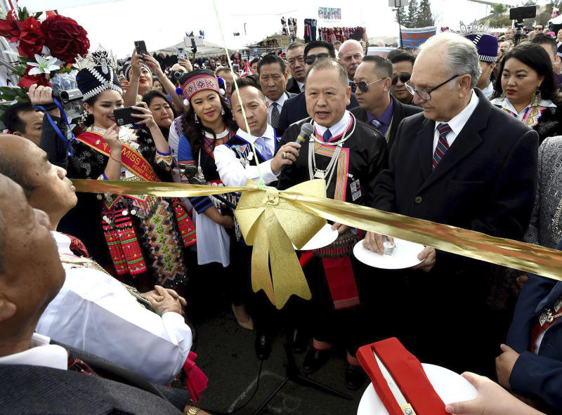 Fresno Mayor Lee Brand, right, joins with other dignitaries in dedication ceremonies kicking off the first day of the Hmong New Year celebration at the Fresno Fairgrounds, Thursday Dec. 26, 2019.  (John Walker/The Fresno Bee via AP)