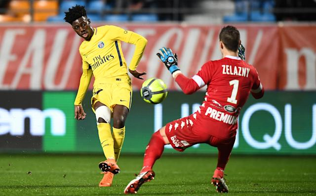 Budding USMNT star Timothy Weah, left, made his first-team debut for Paris Saint-Germain on Saturday. (Getty)