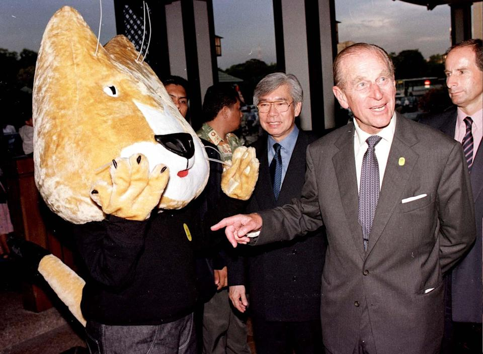 <p>The Duke Of Edinburgh meets Kit the cat, the mascot for Manchester's 2002 hosting of the Commonwealth Games at the current Games in Kuala Lumpur today on the opening day of the Queen's four day State visit to Malaysia. (Photo credit: Arthur Edwards/PA Archive/PA Images) </p>