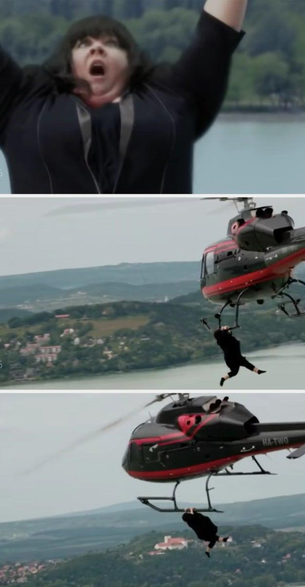 Melissa McCarthy's character tries to hold onto a helicopter while it's midair