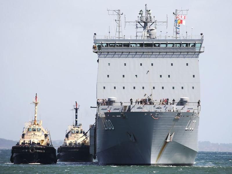 HMAS Choules arrives carrying evacuees from Mallacoota at the port of Hastings, Australia on January 4, 2020. | Pool/Getty Images