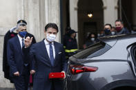 Outgoing Prime Minister Giuseppe Conte leaves Palazzo Chigi Premier office in Rome, Saturday, Feb. 13, 2021. Mario Draghi, credited with largely saving the euro currency, has formally taken the helm of Italy, focused on guiding the country through the pandemic and reviving its economy. Premier Draghi and his Cabinet ministers were sworn into office Saturday at the Quirinal presidential palace in front of President Sergio Mattarella. (Cecilia Fabiano/LaPresse via AP)