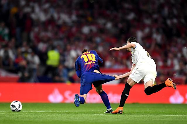 MADRID, SPAIN – APRIL 21: Lionel Messi of Barcelona is pulled down by his shorts by Sevilla's Sergio Escudero during the Spanish Copa del Rey final. (Getty)