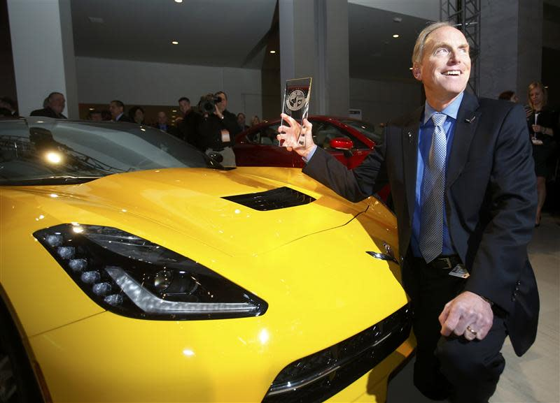 Tadge Juechter chief engineer for the Corvette poses with the Car of the Year Award next to a Corvette Stingray during the press preview day of the North American International Auto Show in Detroit