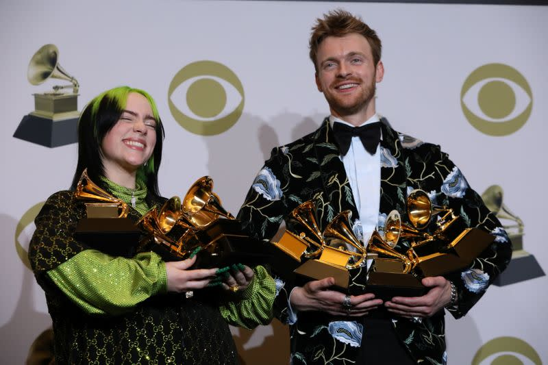 FILE PHOTO: 62nd Grammy Awards – Photo Room – Los Angeles, California, U.S., January 26, 2020 - Billie Eilish and Finneas O'Connell pose backstage with her awards