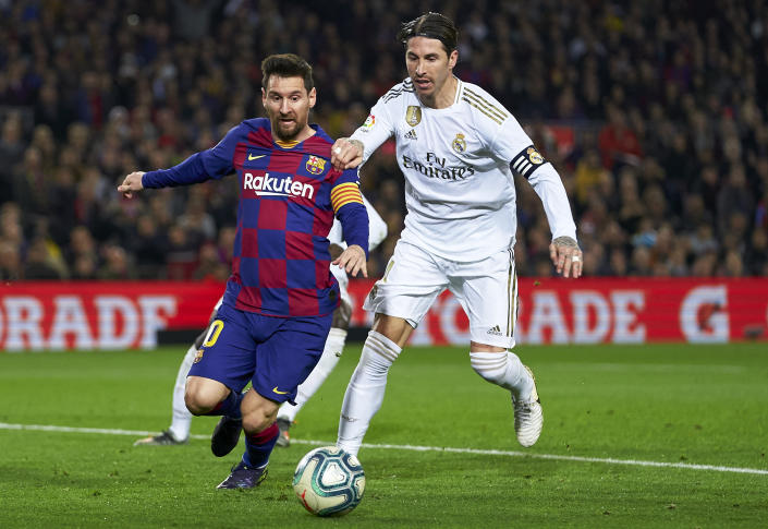 BARCELONA, SPAIN - DECEMBER 18: Lionel Messi of Barcelona is tackled by Sergio Ramos of Real Madrid during the Liga match between FC Barcelona and Real Madrid CF at Camp Nou on December 18, 2019 in Barcelona, Spain. (Photo by Quality Sport Images/Getty Images)