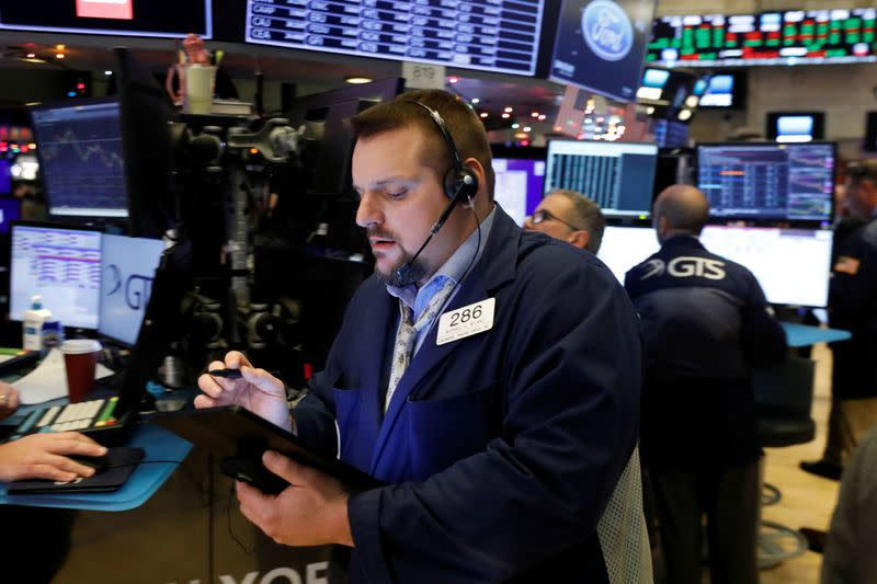 Wall Street climbs on solid jobs data trade hopes
