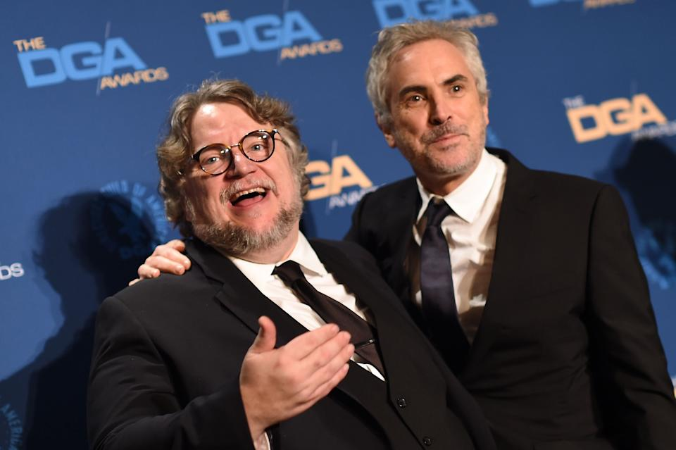 """Director Alfonso Cuaron (R) poses next to director Guillermo Del Toro after receiving the award for Outstanding Directorial Achievement in Feature Film for """"Roma"""" in the press room during the 71st Annual Directors Guild Of America (DGA) Awards at the Ray Dolby Ballroom in Hollywood on February 2, 2019. (Photo by Valerie MACON / AFP)        (Photo credit should read VALERIE MACON/AFP/Getty Images)"""