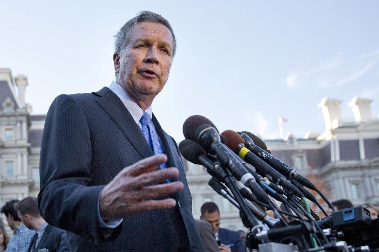 FILE – In this Nov. 10, 2016, file photo, Ohio Gov. John Kasich, following a ceremony where President Barack Obama honored the 2016 NBA champion Cleveland Cavaliers basketball team, answers questions from reporters outside the West Wing of the White House in Washington. Republican governors who turned down billions in federal dollars from an expansion of Medicaid under President Barack Obama's health care law now have their hands out in hopes the GOP Congress comes up with a new formula to provide insurance for low-income Americans. (AP Photo/Pablo Martinez Monsivais, File)