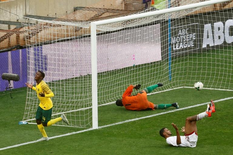 A file photo of South African Teboho Mokoena (L) celebrating scoring against the Seychelles in a 2019 Africa Cup of Nations qualifier