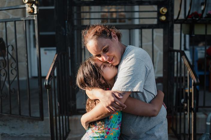 Sharim Anaya and her daughter, Makaila, hug in front of their home in Camden, N.J., June 9, 2020. (Hannah Yoon/The New York Times)
