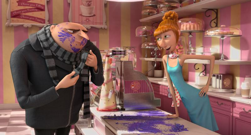 "This film publicity image released by Universal Pictures shows characters Lucy, voiced by Kristen Wiig, right, and Gru, voiced by Steve Carell in ""Despicable Me 2."" (AP Photo/Universal Pictures)"