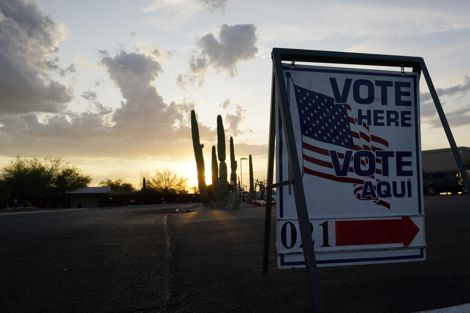The sun sets at a local polling station Tuesday, Nov. 3, 2020 in Tucson, Ariz. (AP Photo/Ross D. Franklin)