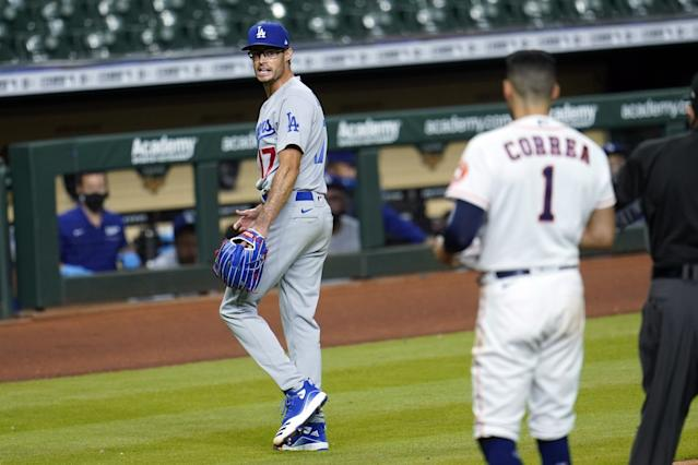 """Dodgers reliever Joe Kelly yells back at Houston Astros shortstop Carlos Correa after the sixth inning of the Dodgers' 5-2 win Tuesday. <span class=""""copyright"""">(David J. Phillip / Associated Press)</span>"""