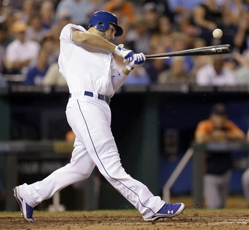 Kansas City Royals' Eric Hosmer hits an RBI-single during the fourth inning of a baseball game against the Detroit Tigers, Wednesday, Aug. 29, 2012, in Kansas City, Mo. (AP Photo/Charlie Riedel)