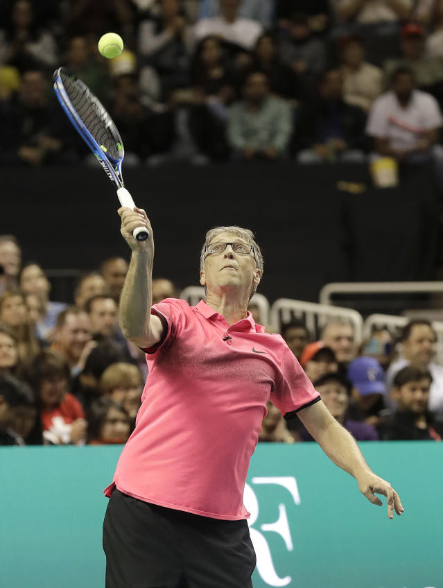 Bill Gates serves the ball as he and partner Roger Federer, of Switzerland, play in an exhibition tennis match against Jack Sock and Savannah Guthrie in San Jose, Calif., Monday, March 5, 2018. (AP Photo/Jeff Chiu)