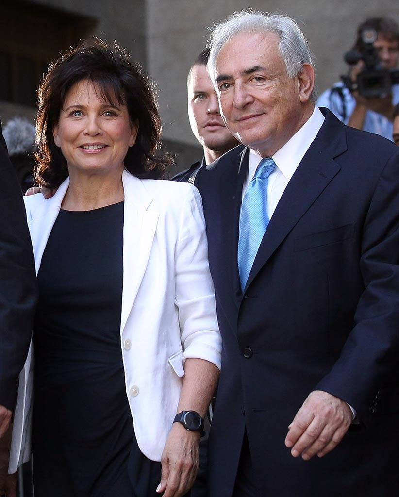 Former International Monetary Fund leader Dominique Strauss-Kahn, right, and his wife, Anne Sinclair, leave a hearing where he was released on his own recognizance at New York State Supreme Court in 2011 in New York City. (Photo: Mario Tama/Getty Images)
