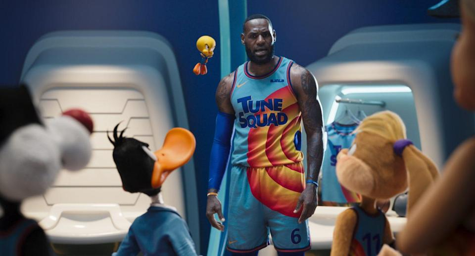 """(L-R Backs to Camera) SYLVESTER, DAFFY DUCK, LOLA BUNNY, (Center frame) LEBRON JAMES, and TWEETY BIRD in Warner Bros. Pictures' animated/live-action adventure """"SPACE JAM: A NEW LEGACY,"""" a Warner Bros. Pictures release."""