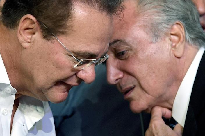 Brazilian Vice President Michel Temer (R) speaks with the president of the Senate Renan Calheiros during the Brazilian Democratic Movement Party (PMDB) national convention in Brasilia (AFP Photo/Evaristo Sa)