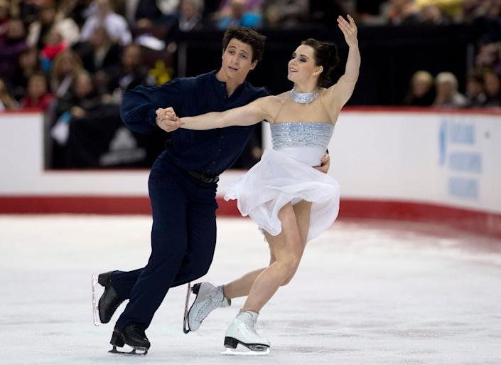 Tessa Virtue and Scott Moir perform their free program in dance competition at the Canadian figure skating championships in Ottawa, Ontario, on Saturday, Jan. 11, 2014. (AP Photo/The Canadian Press, Adrian Wyld)