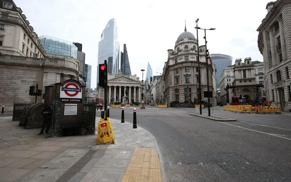 Empty streets around Bank Underground station in London, during the lockdown - Jonathan Brady/PA