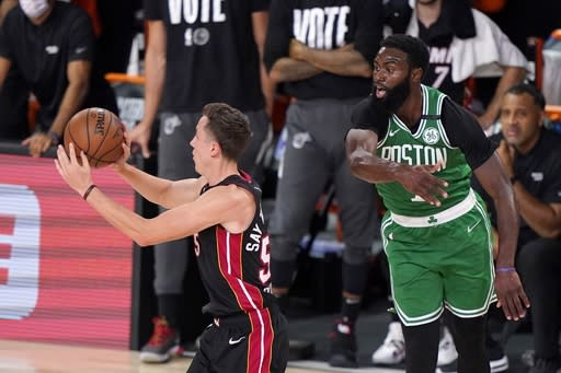 Miami Heat guard Duncan Robinson (55) passes the ball in front of Boston Celtics' Jaylen Brown (7) during the second half of Game 4 of an NBA basketball Eastern Conference final, Wednesday, Sept. 23, 2020, in Lake Buena Vista, Fla. (AP Photo/Mark J. Terrill)