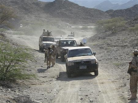 Military vehicles drive on the frontline of fighting against al Qaeda militants in Shabwa