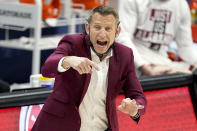 FILE - Alabama head coach Nate Oats directs his players against LSU during the first half of the championship game at the NCAA college basketball Southeastern Conference Tournament in Nashville, in this Sunday, March 14, 2021, file photo. Nobody will get a lump in their throat or start sizing up glass slippers for programs like these Alabama, Illinois, Baylor. They're not underdogs. They're hardly unknown. What they are is a group of new teams with well-recognized names in the NCAA Tournament, and they're hoping to keep making life hard on the programs that have long had a stranglehold on March.(AP Photo/Mark Humphrey, File)