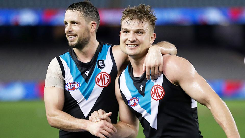 Seen here, Ollie Wines celebrates a goal for Port Adelaide in the AFL finals.