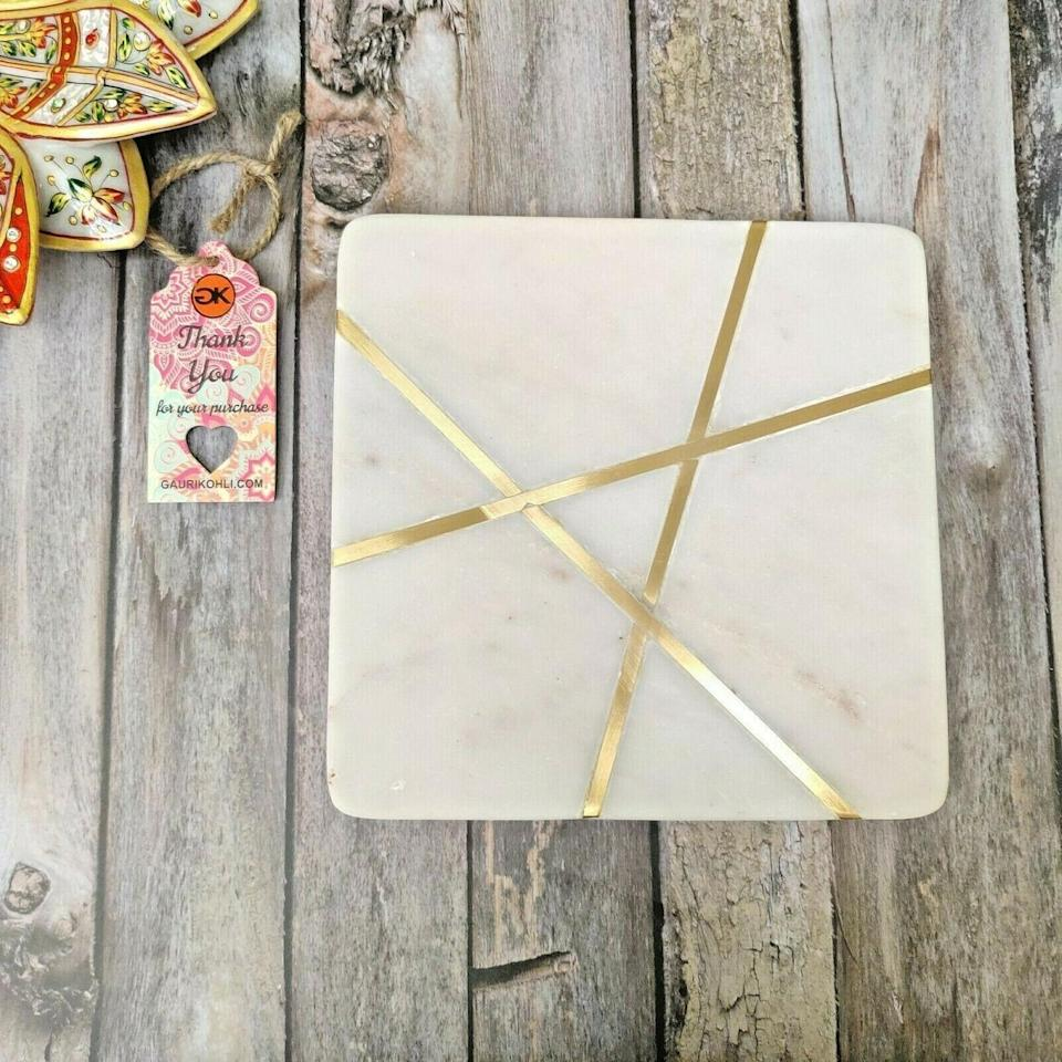 <p>The <span>Badajoz Square Marble Cheese Board</span> ($27, originally $30) is an Instagram-friendly cheese board.</p>