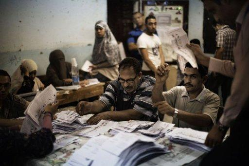 Egyptian election officials count ballots at a polling station in a Cairo school. Vote counting was underway in Egypt after two days of polling ended Thursday in a landmark presidential election which pitted stability against the ideals of the uprising that ended Hosni Mubarak's rule