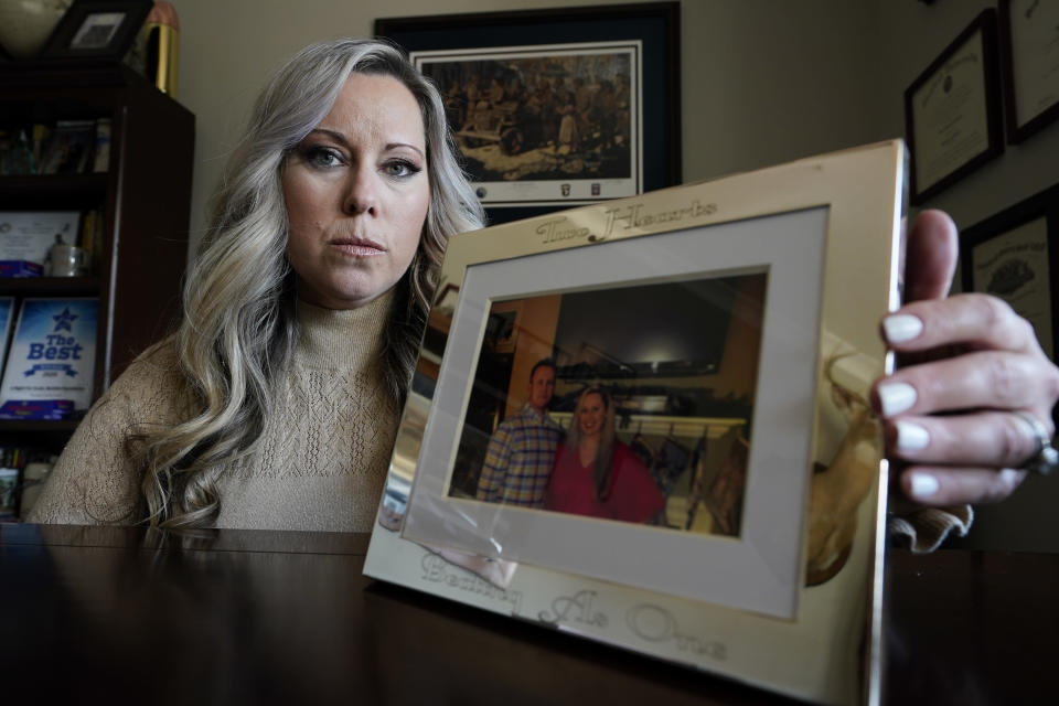 Jill Cichowicz, an advocate for opioid addiction treatment, displays a photo of her and her brother, Scott Zebnwski, who died of an opioid overdose at age 38, in her home in Midlothian, Va., Tuesday, Nov. 24, 2020. (AP Photo/Steve Helber)